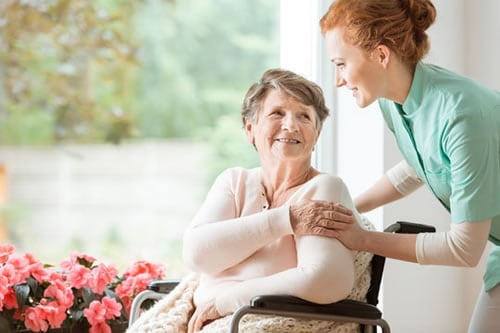 home aide with patient in wheelchair