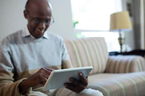 Senior Man on Tablet Smiling